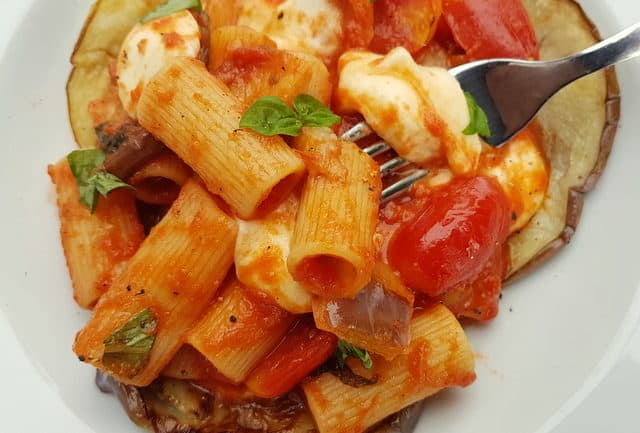 This rich and tasty vegetarian rigatoni pasta alla parmigiana recipe from Southern Italy is made with the same ingredients as eggplant parmigiana and tastes just as wonderful! It can be baked or eaten without baking.