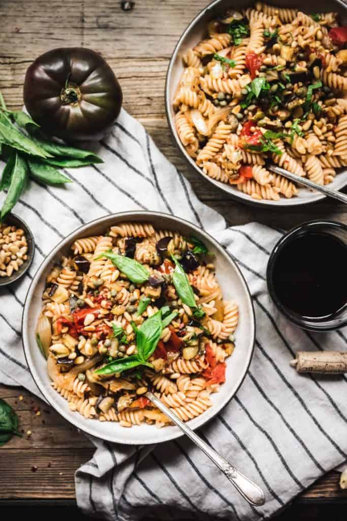 Savory roasted eggplant, umami-rich roasted tomatoes, briny capers, and sweet caramelized onions make this comforting veggie-packed pasta a must-have weeknight dinner.