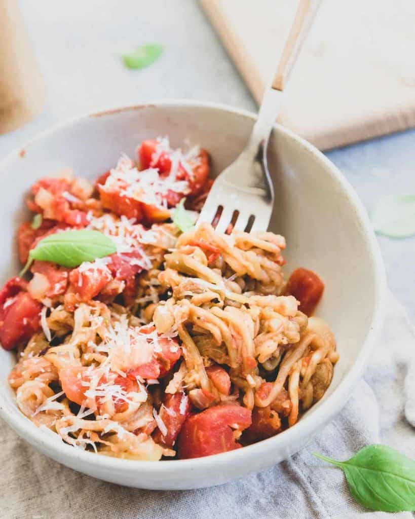 This simple recipe for eggplant noodles is tossed with a quick tomato basil sauce and lots of parmesan cheese for a fresh summer meatless meal.