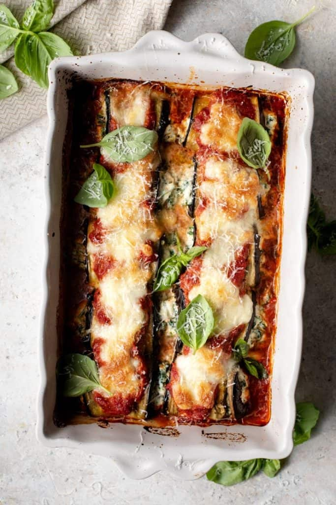 Eggplant rollatini stuffed with a creamy spinach and ricotta filling and baked in the most delicious tomato sauce and topped with mozzarella cheese. A light and easy meal that's sure to impress!