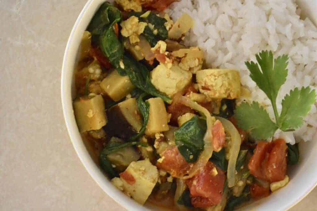 Healthy and delicious Tofu Eggplant Curry is a tasty recipe that you can feel good about eating, plus it's vegetarian and vegan-friendly. Made with curry powder, coconut milk, and spinach, this is a great weeknight dinner that comes together in 30 minutes.