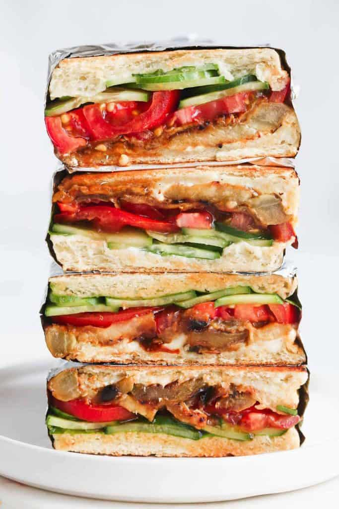 This vegan eggplant sandwich is so delicious that you'll keep making it over and over again. Layers of smoky and fresh vegetables are packed in panini bread, then toasted till perfection! Ideal for lunchboxes, picnics, and lunches on the go!