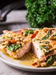 Chicken with spinach and sun dried tomatoes parmesan sauce is an easy simple recipe despite the long name! Try to make this delicious meal for your loved ones.