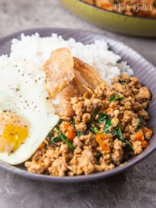 Spicy Thai chicken basil is a flavorful chicken basil stir fry with Thai spices. Sweet, spicy, and savory spices seep into the chicken pieces mix with Thai Basil. Complete it with the warm rice and crispy yolk fried egg on top. It's a quick and easy stir fry that's super delicious!