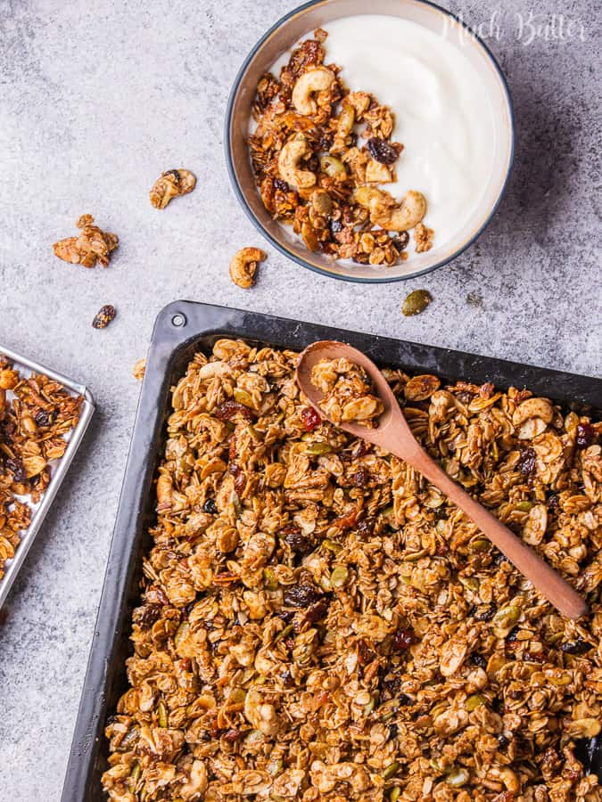 Homemade fruits and nuts granola is healthy snack and breakfast consist of dates honey, granola,seeds, nuts, and dried food. Perfect for diet snack!