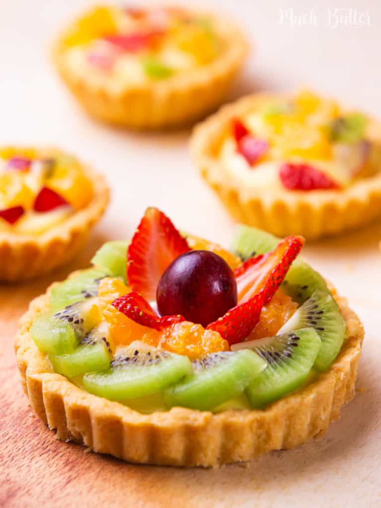 Here's a beautiful Fruit Pastry Cream Tart! You won't resist the fresh and colorful fruits mix with rich pastry cream in a crispy pastry crust. This classic elegant dessert will impress your friend and family. Surprisingly, it is easy to prepare!