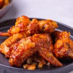 These spicy chicken wings will be a hit for your party, game day, or even a movie night! Everyone will be addicted to this crispy and juicy fried chicken coated with hot, spicy, sticky, and sweet sauce. Don't miss out on the tangy flavor until finger-licking.