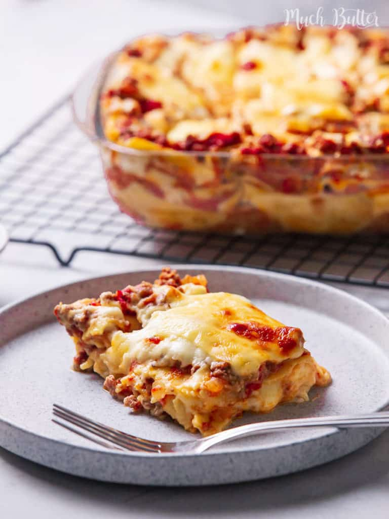 Classic Lasagna with bechamel sauce is the lovely comfort food for family and friends' dinner gatherings! Flavorful layered pasta with rich bolognese meat sauce, white bechamel sauce, and full of melted cheese.