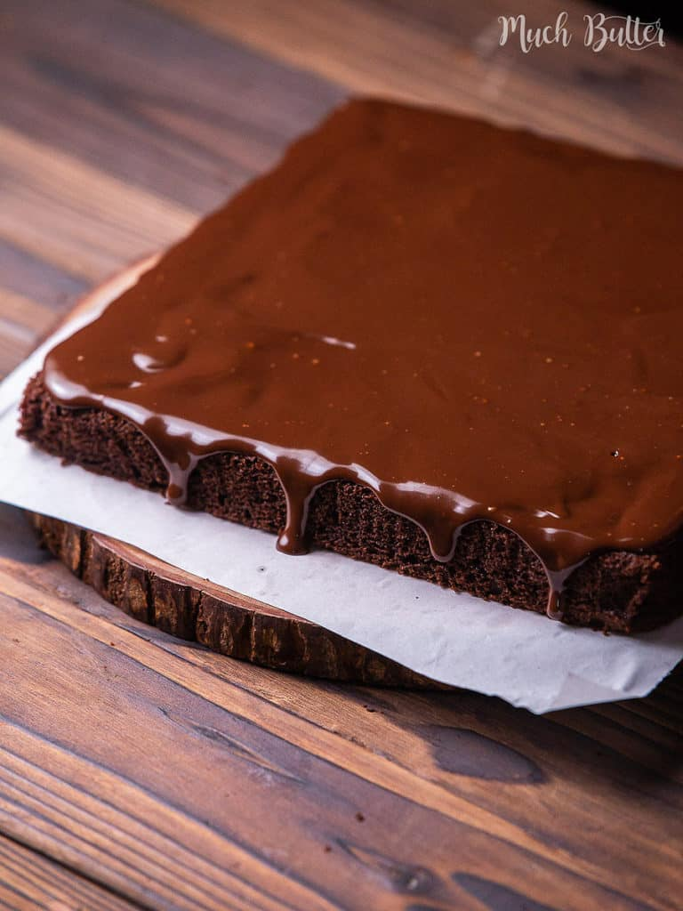 Easy Chocolate Cake with Ganache Frosting is the best moist and fudgy cake for the chocolate lover! Smothered with a creamy chocolate ganache, this fancy and simple cake can be an entertaining dessert even for special days.