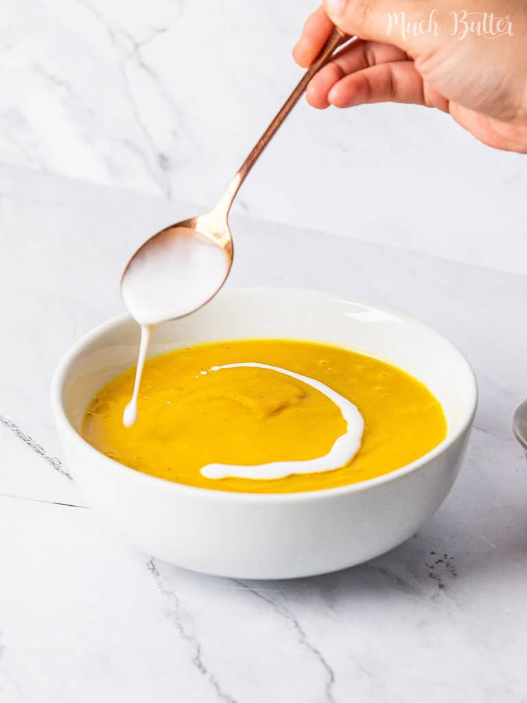 Classic, creamy and light pumpkin soup to comfort in winter or fall season. Simple vegan soup with fresh pumpkin, cinnamon, nutmeg, clove, and coconut cream. Don't keep your family waiting for a flavorful, simmer, and smooth appetizer.